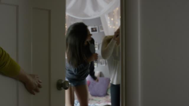 Medium shot of girls caught dancing in bedroom / Cedar Hills, Utah, United States