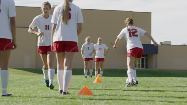 medium shot of girls practicing passing soccer ball / springville, utah, united states - springville utah stock videos & royalty-free footage