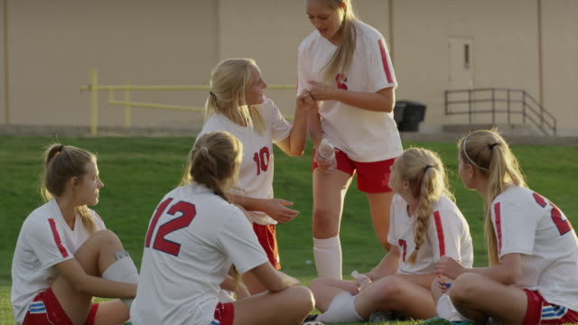 medium shot of girls relaxing after soccer match / springville, utah, united states - football strip stock videos & royalty-free footage