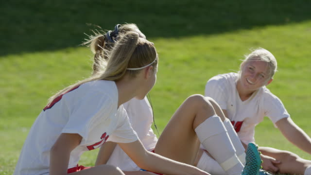medium shot of girls warming up before playing soccer / springville, utah, united states - springville utah stock-videos und b-roll-filmmaterial