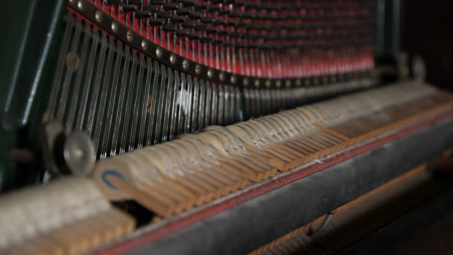 medium shot of hammers quickly hitting strings inside an upright piano - piano stock videos & royalty-free footage