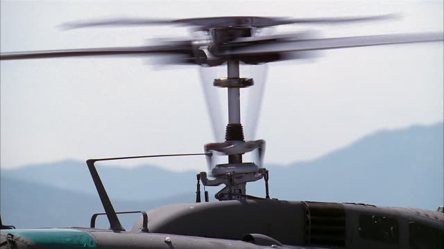 medium shot of helicopter propeller spinning - helicopter stock videos & royalty-free footage