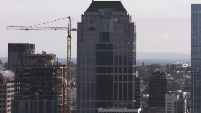 medium shot of high-rise buildings in downtown seattle - crane stock videos & royalty-free footage