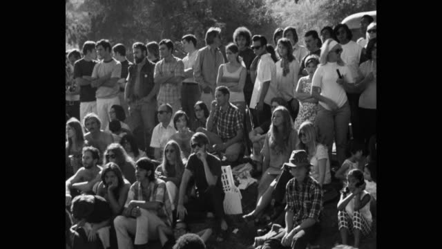 medium shot of hippie people in public park - youth culture stock videos & royalty-free footage