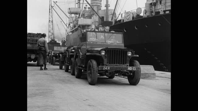 medium shot of jeeps driving by ship at harbor - korean war - korea stock videos & royalty-free footage