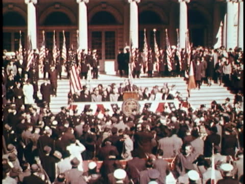 medium shot of john glenn at a lectern with a seated crowd of people behind him that includes vice president lyndon b. johnson. in front of him, the... - alan b. shepard jr stock videos & royalty-free footage
