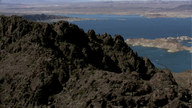 medium shot of las vegas boat harbor with mountain top in the foreground - lake mead video stock e b–roll