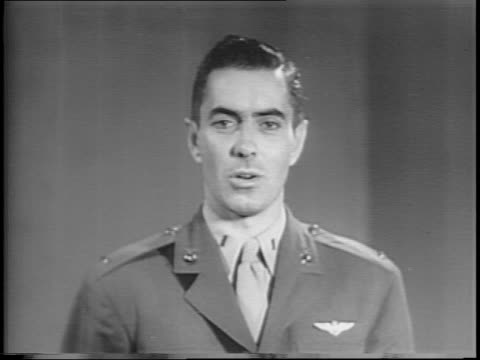 medium shot of lieutenant tyrone power speaking at microphone / power reveals that soldiers buy bonds / wide shot of sailors marching in rows / wide... - uniform stock videos & royalty-free footage