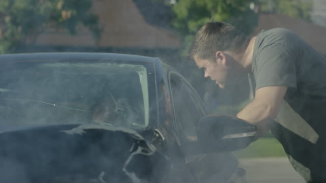 medium shot of man checking car accident / pleasant grove, utah, united states - autounfall stock-videos und b-roll-filmmaterial