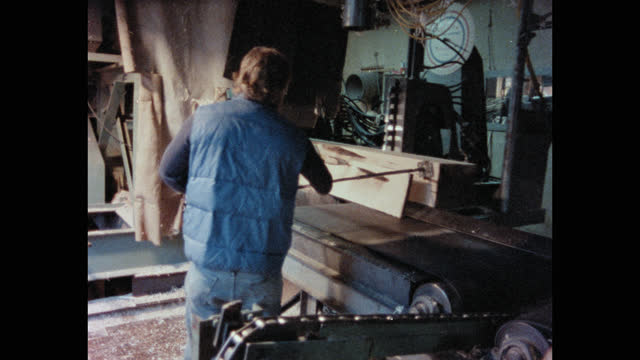 medium shot of man moving wooden planks on conveyor belt in lumberyard, maine, usa - forestry industry stock videos & royalty-free footage
