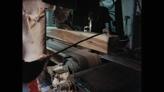 medium shot of man's hands moving wooden planks on conveyor belt in lumberyard, maine, usa - forestry industry stock videos & royalty-free footage