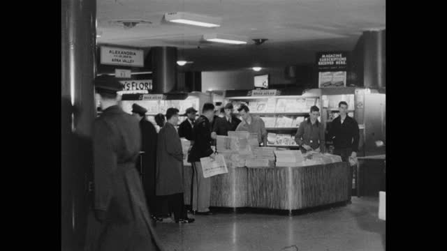 medium shot of men and women buying books and newspapers from newsstand at pentagon station, pentagon, alexandria, virginia - the pentagon stock videos & royalty-free footage