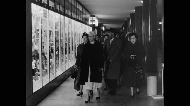 medium shot of men and women walking through the pentagon train station, pentagon, alexandria, virginia - arlington virginia stock videos & royalty-free footage