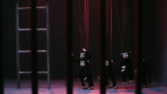 medium shot of monkey puppets dancing besides ladder on stage during puppet show - puppet stock videos & royalty-free footage