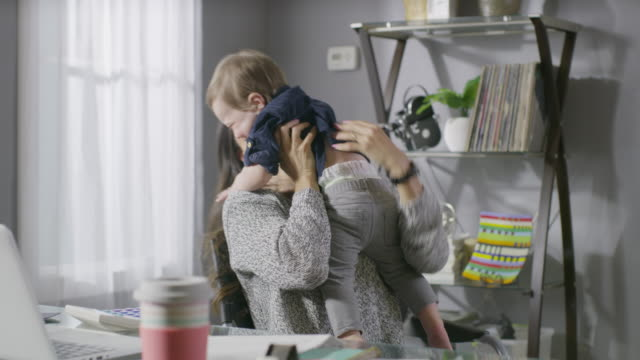 stockvideo's en b-roll-footage met medium shot of mother spinning in chair holding son / cedar hills, utah, united states - huis interieur