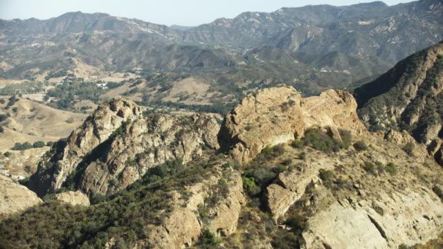 medium shot of mountain ridges in malibu creek park - malibu stock videos and b-roll footage
