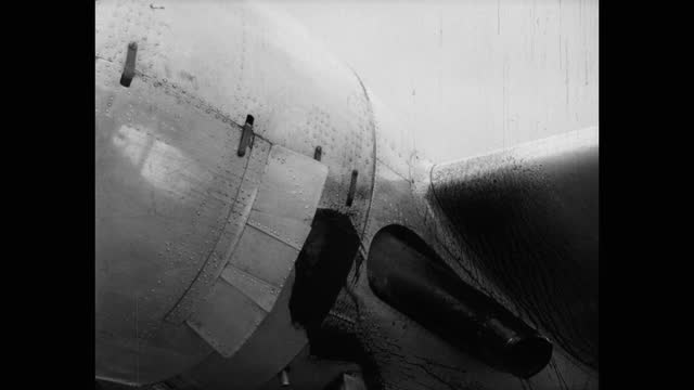 medium shot of oil leaking from military airplane - leaking stock videos & royalty-free footage