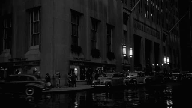 medium shot of pedestrians and traffic on busy street, park avenue, new york city at night, new york state, usa - 1941 stock videos & royalty-free footage