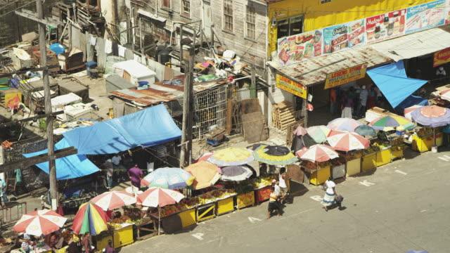 medium shot of people browsing street market stalls - guyana stock videos & royalty-free footage