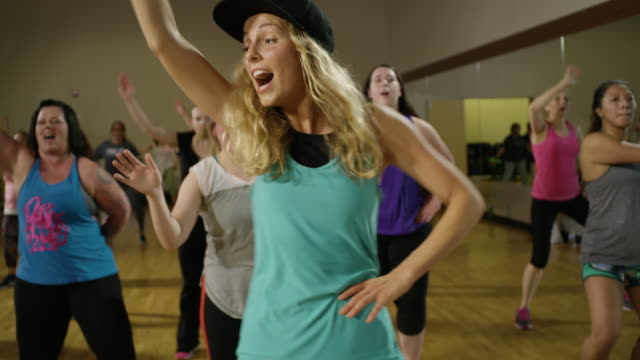 medium shot of people dancing in exercise class / orem, utah, united states - weitere themen stock-videos und b-roll-filmmaterial