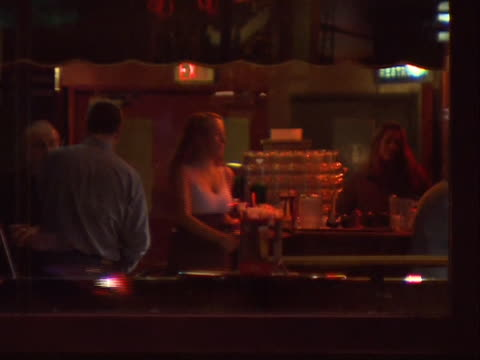medium shot of people in a bar in vancouver, canada. vancouver is a coastal seaport city on the mainland of british columbia, canada. it is the hub... - healthcare and medicine or illness or food and drink or fitness or exercise or wellbeing stock videos & royalty-free footage