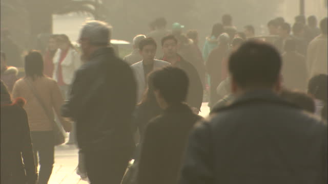 medium shot of people in the street - smog video stock e b–roll