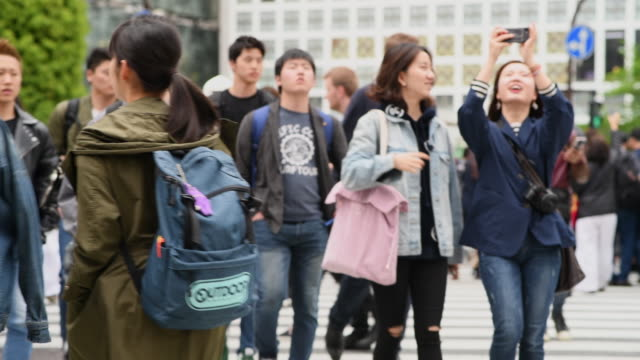 medium shot of people walking on shibuya crossing - shibuya ward stock videos & royalty-free footage