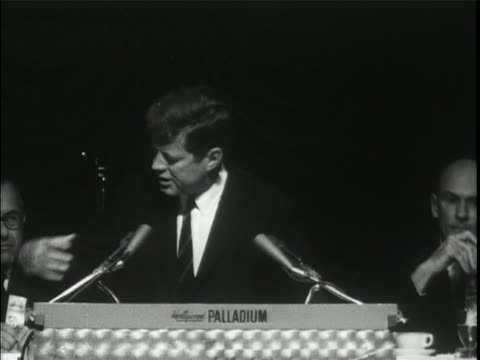 "medium shot of president john f. kennedy standing at a lectern with the words ""hollywood palladium"" written on it. he has two microphones in front of... - united states and (politics or government) stock videos & royalty-free footage"