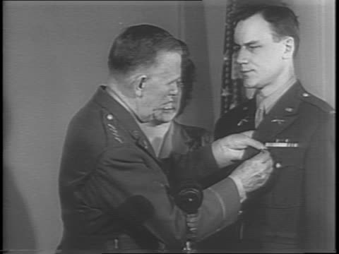 medium shot of president roosevelt awarding gerry kisters with the congressional medal of honor as he places it around his neck / shot of kisters... - embankment stock videos and b-roll footage