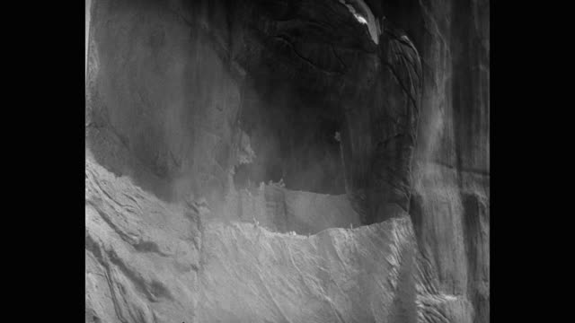 medium shot of rock falling at entrance of cave in desert - shaking stock videos & royalty-free footage