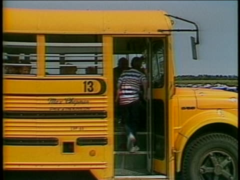 medium shot of ryan white walking through the front doors of his school. he is accompanied by a man wearing a red blazer. the man in the blazer walks... - schoolhouse stock videos & royalty-free footage
