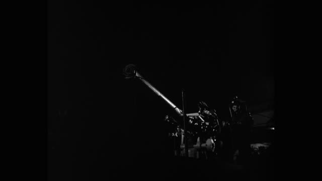 medium shot of sailors firing with cannon at night - cannone video stock e b–roll