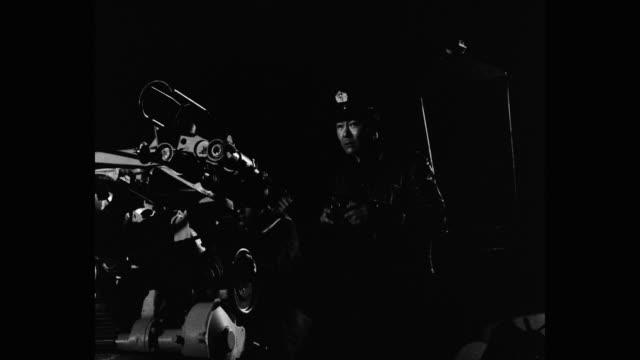 medium shot of sailors firing with cannon at night - binoculars stock videos & royalty-free footage