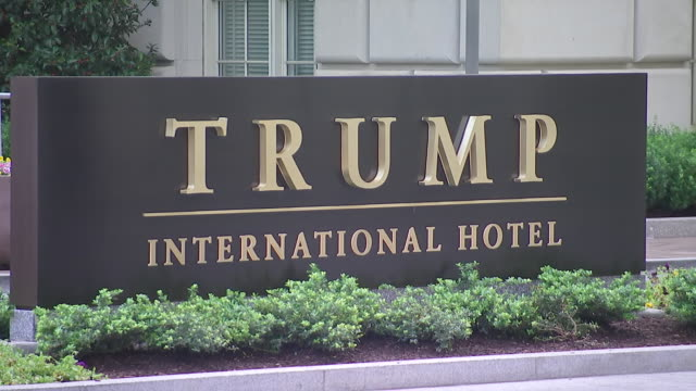 medium shot of sign outside of trump international hotel on pennsylvania avenue in washington dc - pennsylvania avenue video stock e b–roll
