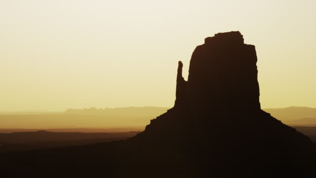 Medium shot of silhouetted rock formation in Monument Valley / Monument Valley, Utah, United States,