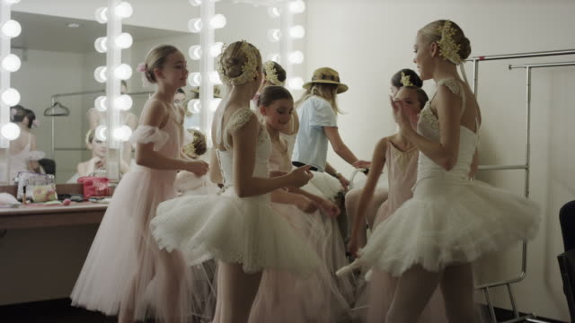 medium shot of smiling ballerinas talking in dressing room / salt lake city, utah, united states - primary age child stock videos and b-roll footage