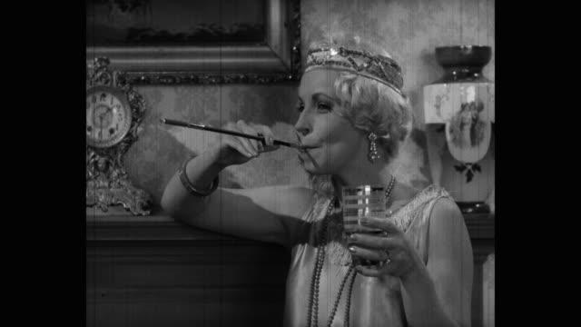 medium shot of smiling woman talking while smoking indoors - leaning stock videos & royalty-free footage