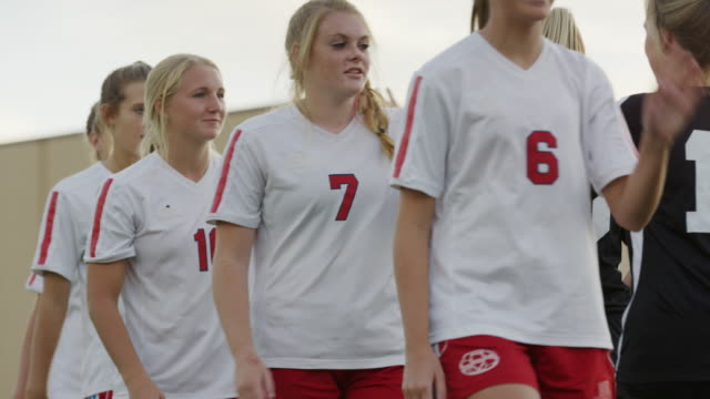 medium shot of soccer opponents walking and high-fiving / springville, utah, united states - springville utah stock videos & royalty-free footage