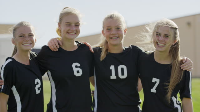 medium shot of soccer players hugging and laughing / springville, utah, united states - springville utah stock videos & royalty-free footage