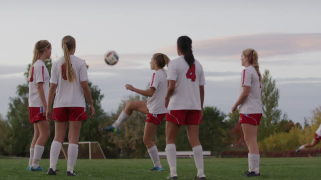 medium shot of soccer players practicing keepie uppie / springville, utah, united states - springville utah stock videos & royalty-free footage