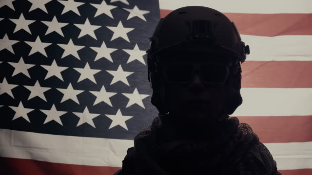 medium shot of soldier portrait with usa flag background. - military recruit stock videos & royalty-free footage