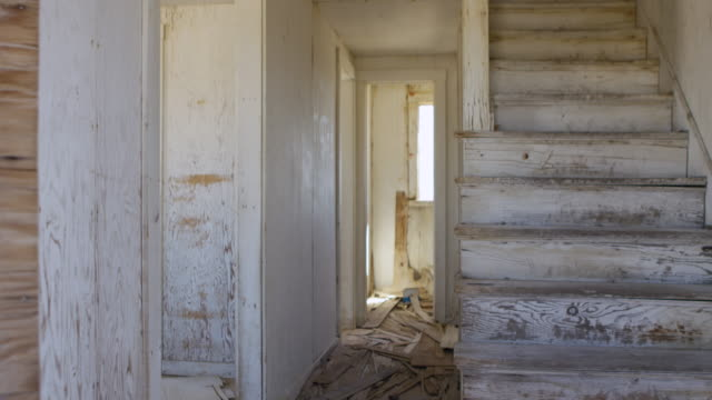 medium shot of stairs and a corridor inside a house at nevada test site - abandoned stock videos & royalty-free footage
