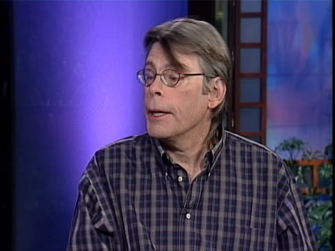 medium shot of stephen king giving an interview in a studioêwearingêbutton down shirt andêglasses. stephen king says and ah a little detour on the... - science fiction film stock videos & royalty-free footage