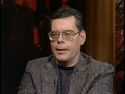 medium shot of stephen king giving an interview in a studio. he is wearing a blazer and glasses. stephen king says i've always sort of seen what a... - science fiction film stock videos & royalty-free footage