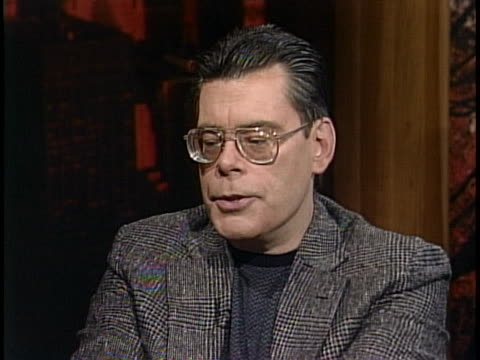medium shot of stephen king giving an interview wearing a blazer and glasses. stephen king says iêdon'têknow i have a nature were i tend toêbrood... - science fiction film stock videos & royalty-free footage