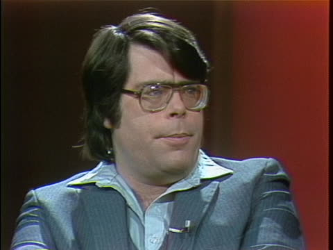 medium shot of stephen king in a studio doing an interview. he is wearing a suit and large glasses. stephen king says people think horror is fun and... - science fiction film stock videos & royalty-free footage