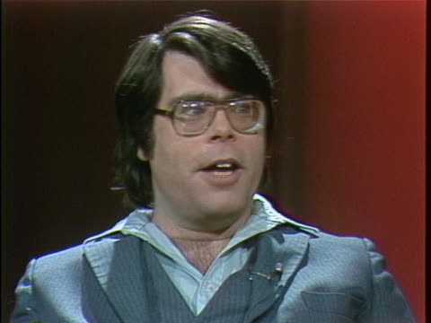 medium shot of stephen king on a set talking in an interview. he is wearing a suit and glasses. he is talking about horror stories and you arent in... - science fiction film stock videos & royalty-free footage