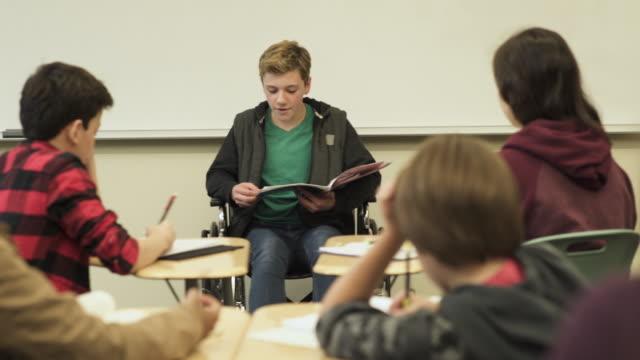 Medium shot of student presenting to class
