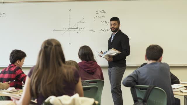 medium shot of teacher holding math class - junior high stock videos & royalty-free footage