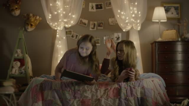 """medium shot of teenage girls sharing digital tablet in bedroom / cedar hills, utah, united states"" - only teenage girls stock videos and b-roll footage"